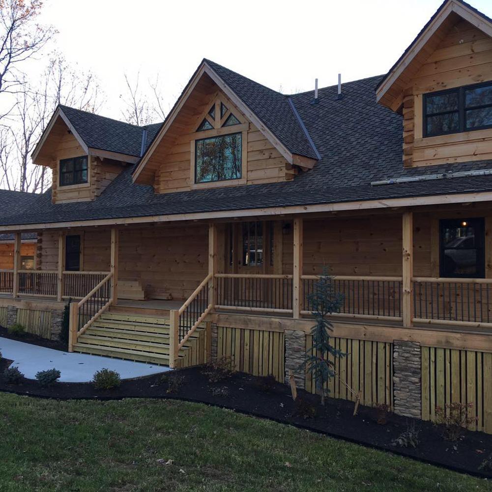 Cedar barn door flotsam cedar county garage door exterior for Unique house siding